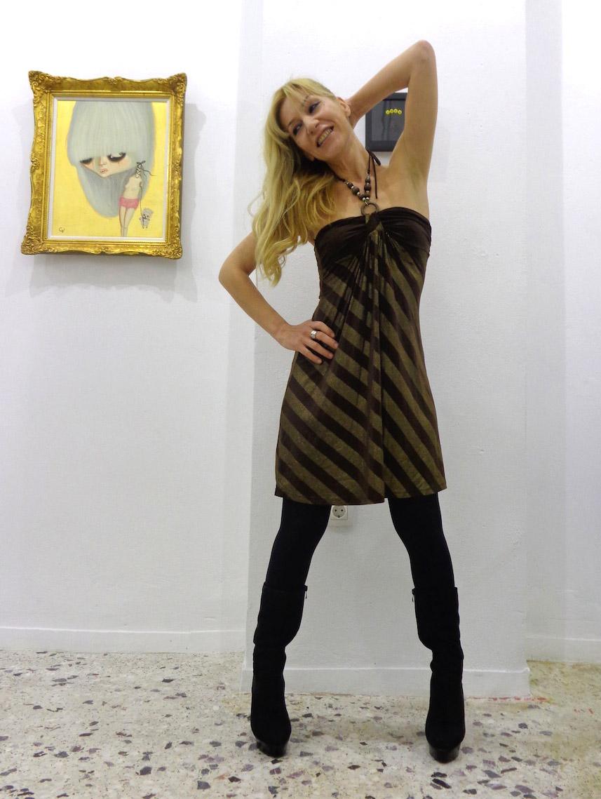 Alexandra Kollaros portrait with Vraziotis artwork